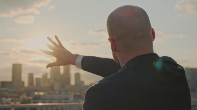 the world is mine. businessman planning strategy - corporate business stock videos & royalty-free footage