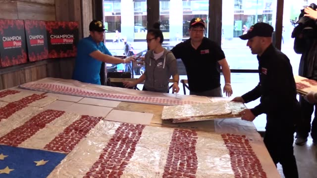 the world pizza champion turkishamerican pizzeria hakki akdeniz displays a huge pizza in shape of us flag at his restaurant to mark 'memorial day'... - biggest stock videos & royalty-free footage
