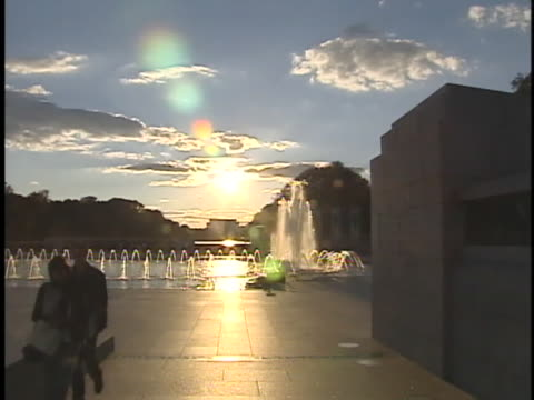 the world war ii memorial glistens in the sunlight at golden hour. - war memorial stock videos & royalty-free footage
