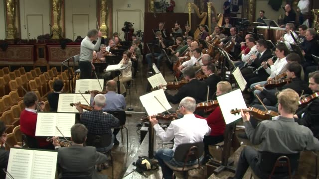 the worldfamous new year's concert by the vienna philharmonic orchestra broadcast as far as uruguay and australia and normally sold out a year in... - austrian culture stock videos and b-roll footage