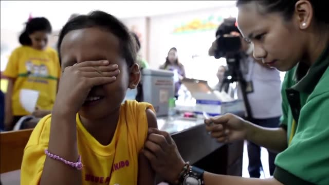 the worlds first public dengue vaccination programme is launched in the philippines as nurses begin injecting the first batch of a million children... - philippines stock videos & royalty-free footage