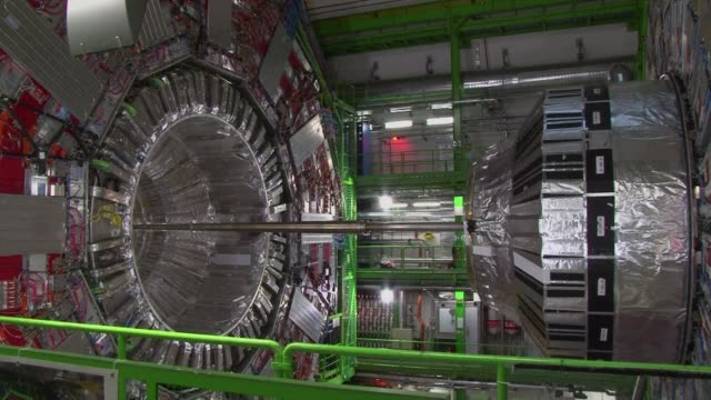 vídeos de stock e filmes b-roll de the worlds largest particle smasher restarts after a two year upgrade that will allow physicists to explore uncharted corners of what makes up the... - física