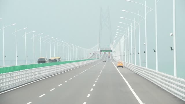 The world's longest sea bridge connecting Hong Kong Macau and mainland China opened to traffic Wednesday with excited travellers making their first...