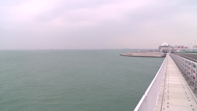 the world's longest sea bridge connecting hong kong macau and the chinese mainland is ready to open to traffic on october 24 2018 after complaints... - surrounding stock videos & royalty-free footage