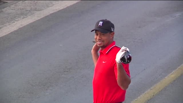the world's number one golfer tiger woods hits the balls from east to west on bosphorus bridge that connects continents of europe and asia on the... - july 15 martyrs' bridge stock videos & royalty-free footage