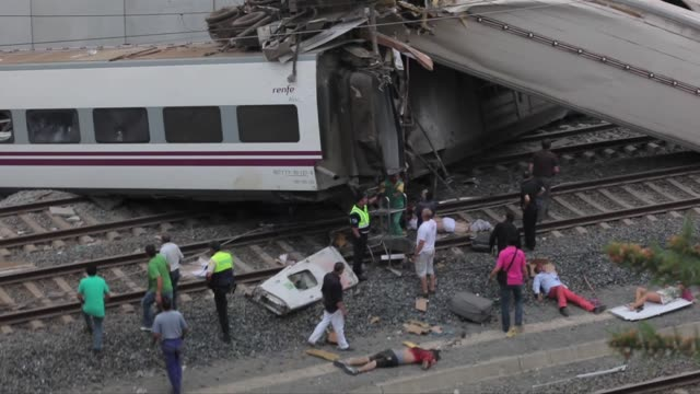 the worst train accident in the last 40 years history of spain left 79 dead and 140 injured people the train derailed in the curve of angrois due to... - train crash stock videos and b-roll footage