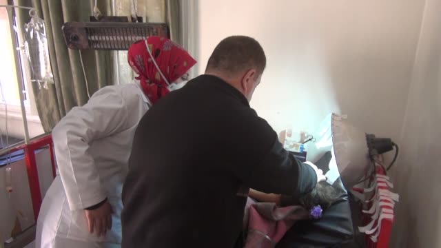The wounded receive the treatment at a sahra hospital after alleged chlorine gas attack of Assad regime to Khan Shaykhun district of Idlib Syria on...