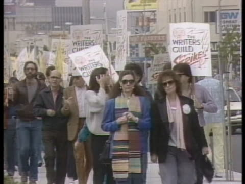 the writers guild of america goes on strike march 7, 1988 in los angeles, california. - author stock videos & royalty-free footage