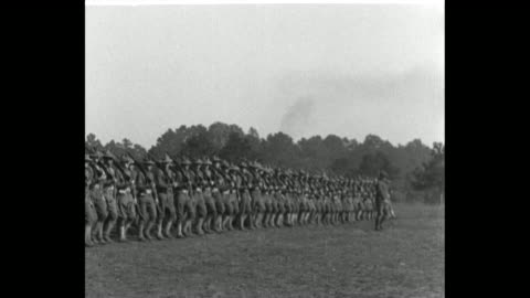 vídeos de stock, filmes e b-roll de the wwi oregon national guard portland 3rd regiment marches in rows two by two / soldiers do squats with outstretched arms circling / pan left... - jogo de carniça