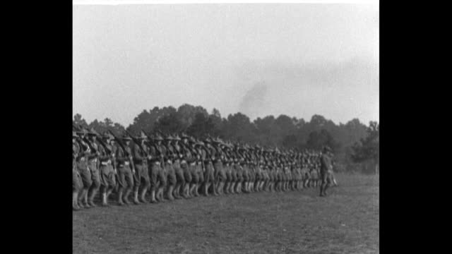 the wwi oregon national guard portland 3rd regiment marches in rows two by two / soldiers do squats with outstretched arms circling / pan left... - hoppa bock bildbanksvideor och videomaterial från bakom kulisserna