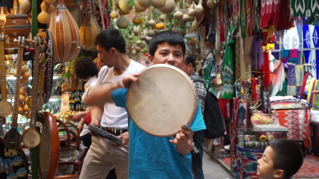 the xinjiang international grand bazaar, an islamic bazaar in ürümqi, is the largest bazaar in the world by scale and one of the most famous... - drum percussion instrument stock videos & royalty-free footage