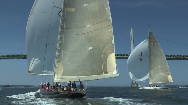 The yachts Ranger and Velsheda race toward a bridge in the J Class Regatta out of Newport.