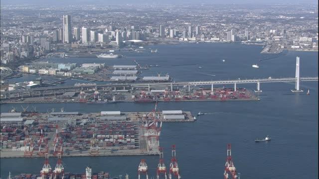 the yokohama bay bridge spans yokohama harbor in japan. - yokohama stock videos and b-roll footage
