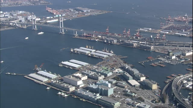 The Yokohama Bay Bridge spans Yokohama Harbor in Japan.
