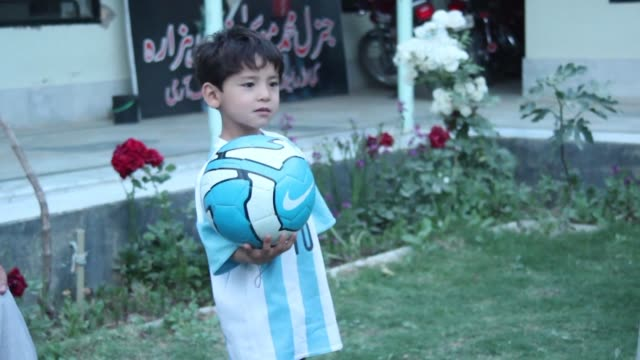 The young Afghan boy who captivated hearts after he was pictured wearing a plastic bag as an improvised Lionel Messi jersey has appealed to the UN...