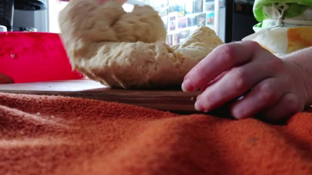 the young girl kneads a dough. closeup video with the focus on hands. - biscuit stock videos & royalty-free footage