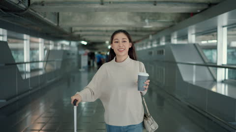 the young lady came to the airport early to prepare for the trip. - reportage stock videos & royalty-free footage