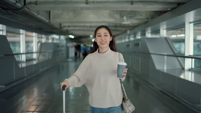 the young lady came to the airport early to prepare for the trip. - travel destinations stock videos & royalty-free footage