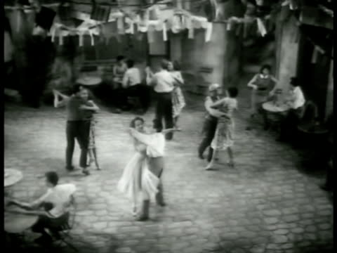 vídeos y material grabado en eventos de stock de the young male sees the young woman crying by building they begin to ballet dance again male signaling three couples & the lovers dancing a mix of... - 1952