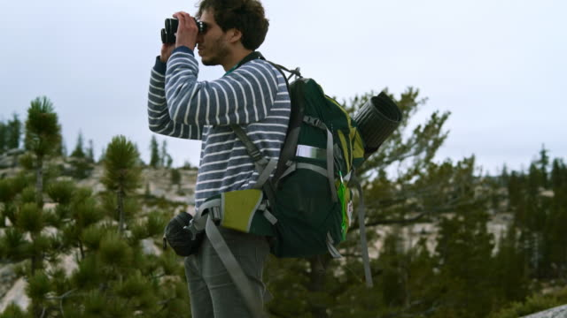 the young man, hipster, tourist - hiker and backpacker, observing the yosemite from the  olmsted point - looking around stock videos & royalty-free footage