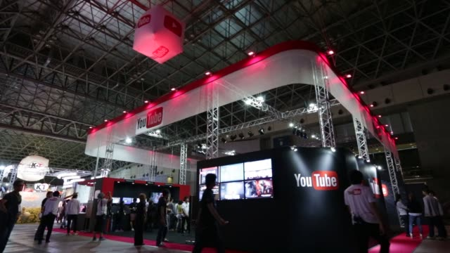 stockvideo's en b-roll-footage met the youtube inc. booth stands at the tokyo game show 2015 at makuhari messe in chiba, japan, on friday, sept. 18, 2015. shots: the youtube inc. logo... - television game show