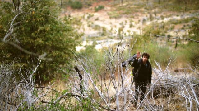 The yung man, traveler - backpacker, hiking in the Yosemite National Park at fall.