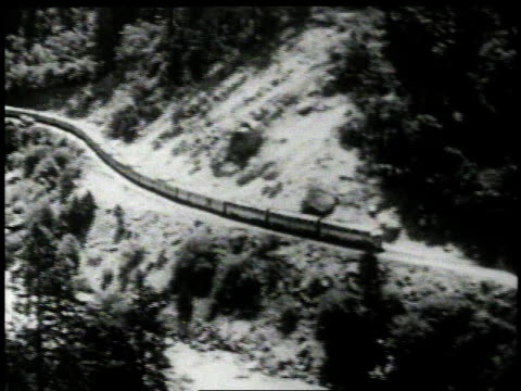 1950 montage the zephyr crosses a bridge at the feather river canyon / united states - interno di treno video stock e b–roll