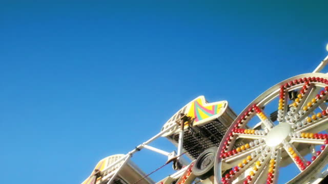 the zipper amusement park ride - fairground ride stock videos & royalty-free footage