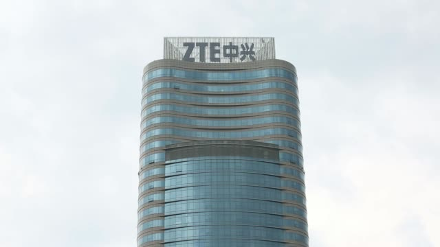 the zte corp headquarters stands in the nanshan district of shenzhen china on thursday aug 7 zte corp signage is displayed atop the companys... - welcome mat stock videos and b-roll footage
