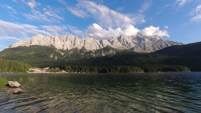 the zugspitze from the eibsee is reflected in the surface on august 10, 2021 near garmisch-partenkirchen, germany. the zugspitze is 2962 meters above... - tranquil scene stock videos & royalty-free footage