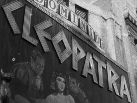 theater marquee cleopatra / crowd pan across road to theatre / celebrities arrive anne heywood laya raki police control crowd / yul brynner and woman... - cleopatra stock videos & royalty-free footage