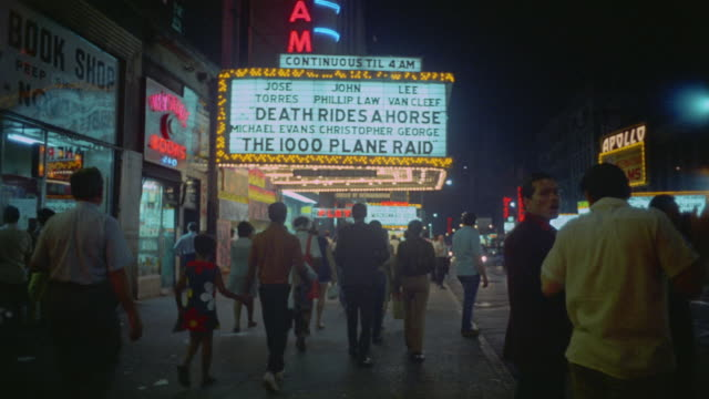 1969 montage theater marquees and pedestrians along 42nd street in times square / new york city - anno 1969 video stock e b–roll