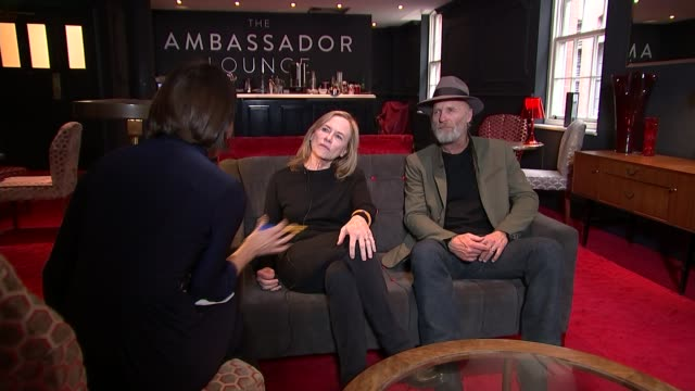 'buried child' ed harris and amy madigan interview england london int amy madigan and ed harris setup shots with reporter / interview sot - amy madigan stock videos & royalty-free footage
