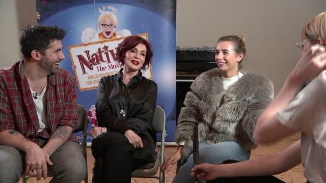 hit christmas musical 'nativity' returns; england: london: int dani dyer , simon lipkin and sharon osborne interview sot - シャロン オズボーン点の映像素材/bロール