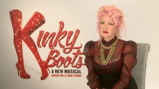 stockvideo's en b-roll-footage met 'kinky boots' opens in west end; england: london: int cyndi lauper interview sot cutaway reporter - cyndi lauper