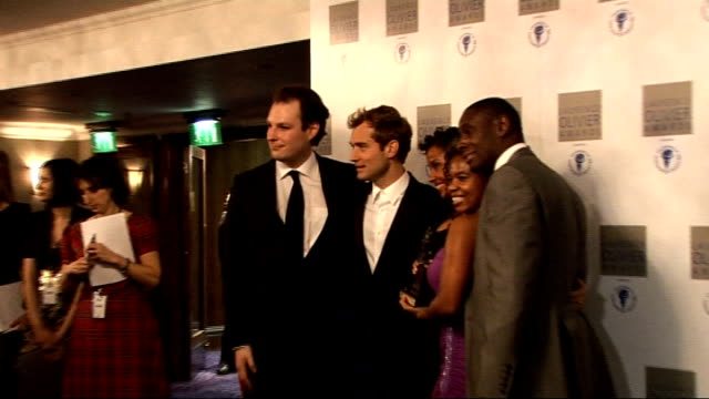 laurence olivier awards 2010; jude law photocall with group of actors including playwright katori hall - scriptwriter stock videos & royalty-free footage