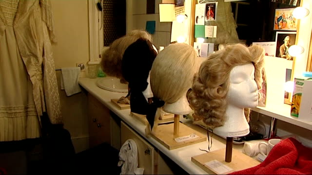 stockvideo's en b-roll-footage met new production of the madness of king george costumes for the production hanging up in the wardrobe department martin de cerjat interview sot talks... - pruik