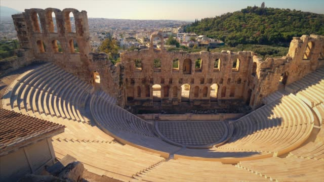 theatre of dionysus below the acropolis in athens, greece is considered to be the worlds first theater aka odeon of herodes atticus - acropolis athens stock videos & royalty-free footage