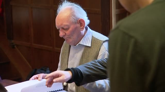 playwright brian friel dies file date and location unknown int brian friel standing chatting at theatre drinks event / brian friel seated at play... - scriptwriter stock videos & royalty-free footage