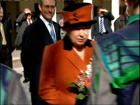 theatre royal brighton visit ext queen leaving building and meeting bicycle ballet performers and chatting as along sot / queen greeting wellwishers... - theatre royal stock videos and b-roll footage