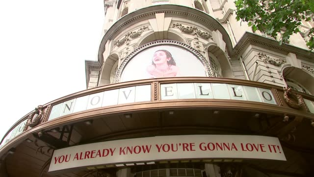understudy steps in for 'mamma mia' halfway through another show england london aldwych sot*** low angle view novello theatre sign wide shot people... - aldwych theatre stock videos & royalty-free footage