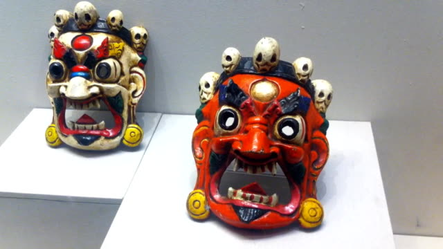 Theatrical masks are on display