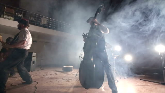 theatrical performance of young rock and roll band - bass guitar stock videos and b-roll footage