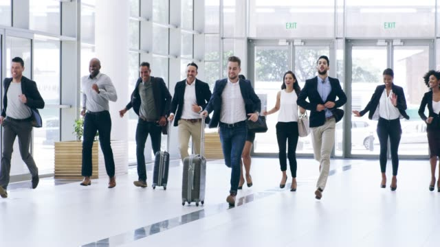 their flight's leaving...now! - persone d'affari video stock e b–roll