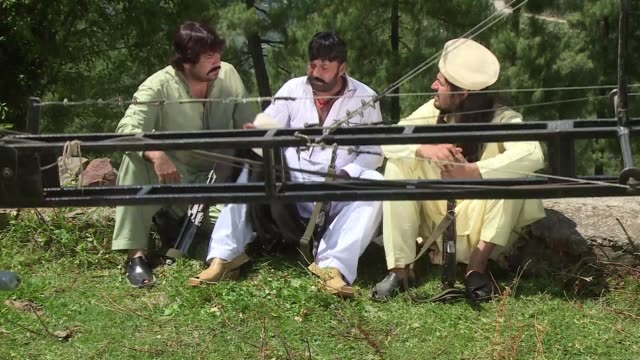 their tunics drenched in sweat hundreds gather by the big screen shouting and dancing their pride in being pashtun amid clouds of hashish - drenched stock videos & royalty-free footage