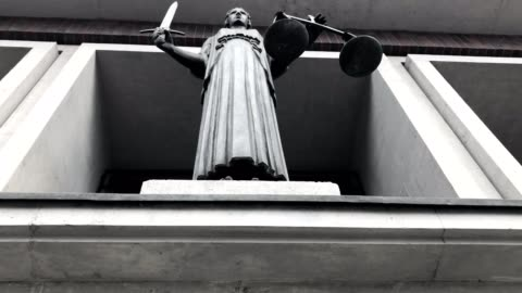 themis with scale and sword in court - legal trial stock videos & royalty-free footage