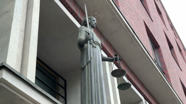 themis with scale and sword in front of court - lady justice stock videos and b-roll footage