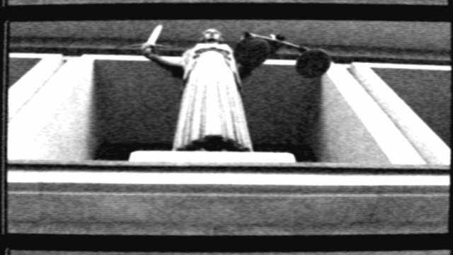 themis with scale and sword in front of court - eastern european culture stock videos & royalty-free footage