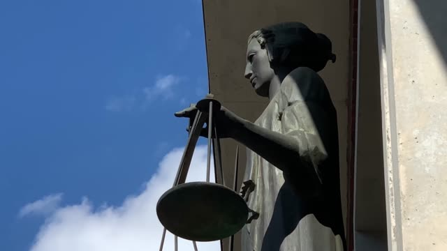 themis with scale and sword in front of court - justice concept stock videos & royalty-free footage