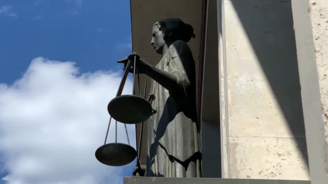 themis with scale and sword in front of court - supreme court justice stock videos & royalty-free footage